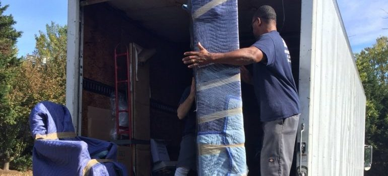 our movers Maryland loading furniture into a truck