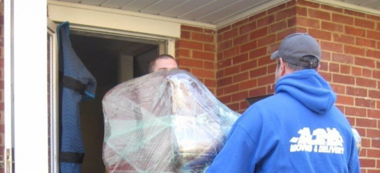 two movers Virginia carrying furniture