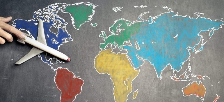 airplane toy on the world map