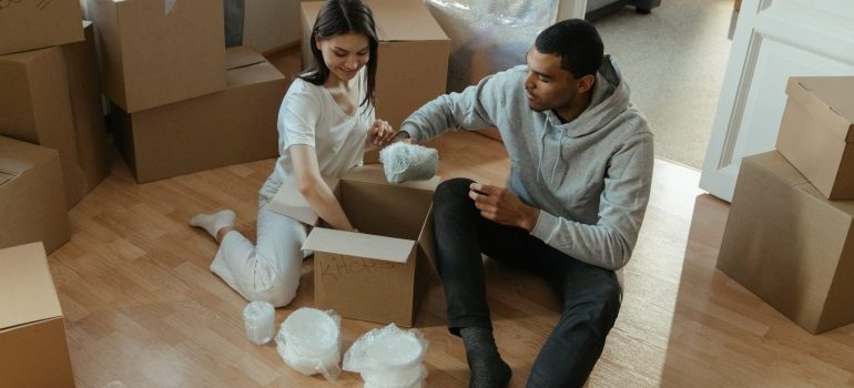 a couple preparing for the relocation, packing process and waiting for our DC apartment movers