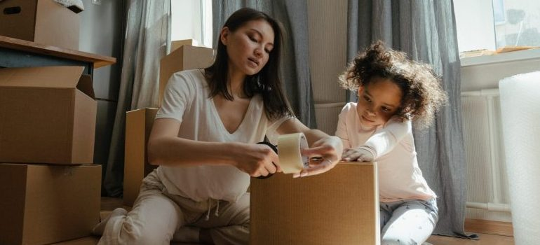 mother and daughter packing for the move