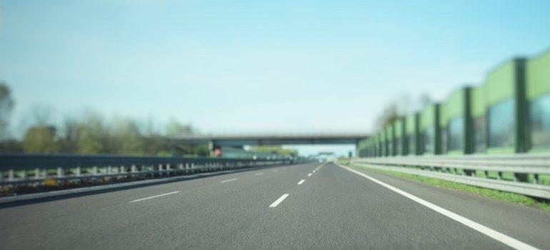 A low-level view of a highway during the day.