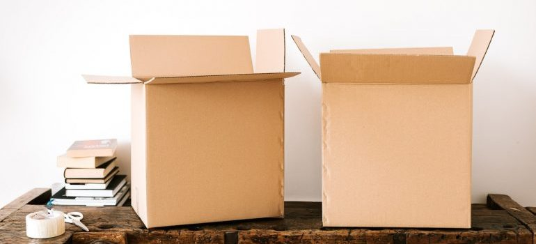 A pair of cardboard boxes on a table, which interstate movers in DC can relocate.