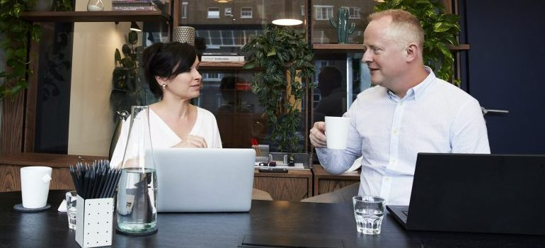 two people sitting in the office space, business meeting
