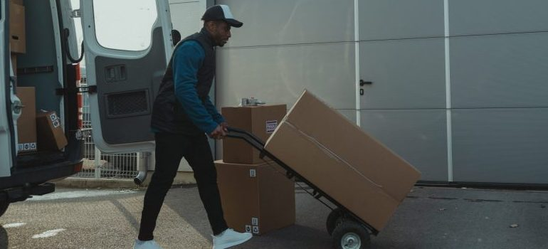 professional mover using a dolly