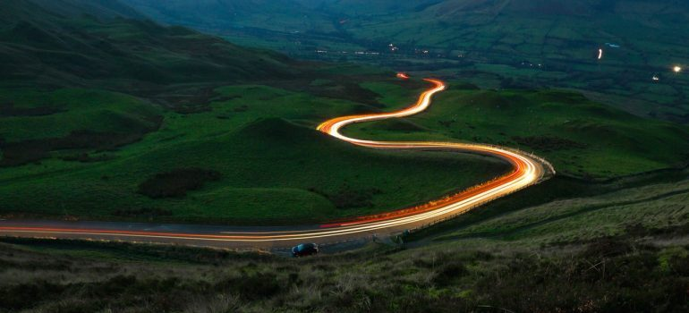 A long exposure shot of a windy road at dusk.