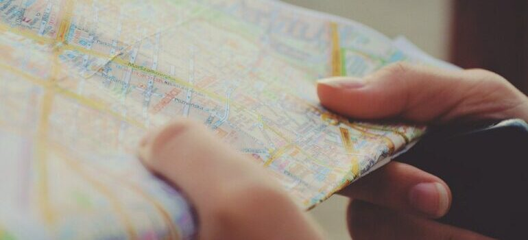 A person looking at a map.