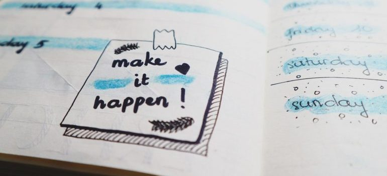"""A notebook drawing saying """"make it happen"""", as inspiration for hiring local movers in Northern VA."""