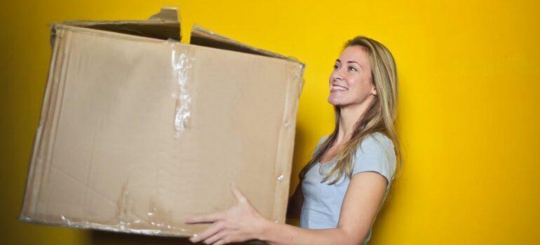 woman holding the cardboard box