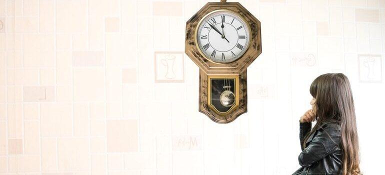 Girl looking at the clock