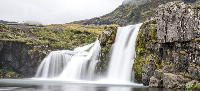a waterfall with water splashing