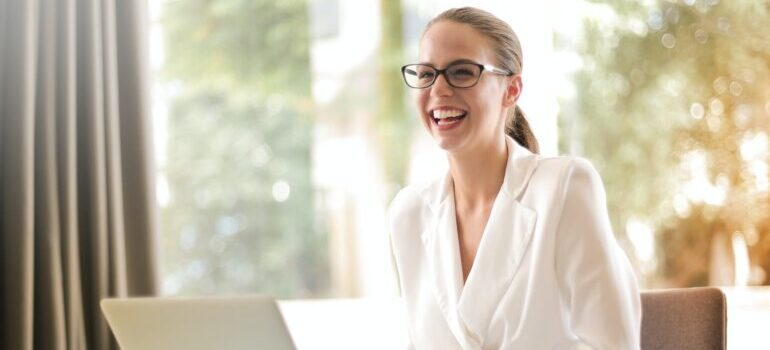 A woman sitting in an office and smiling