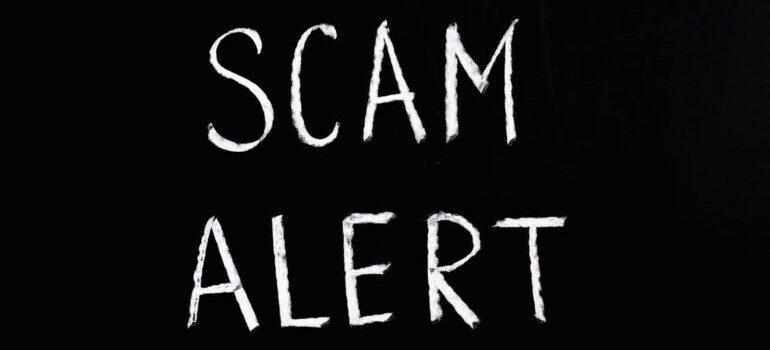 Scam alert written in white on the black background
