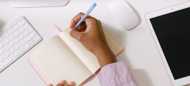 Woman making a plan in her notebook.