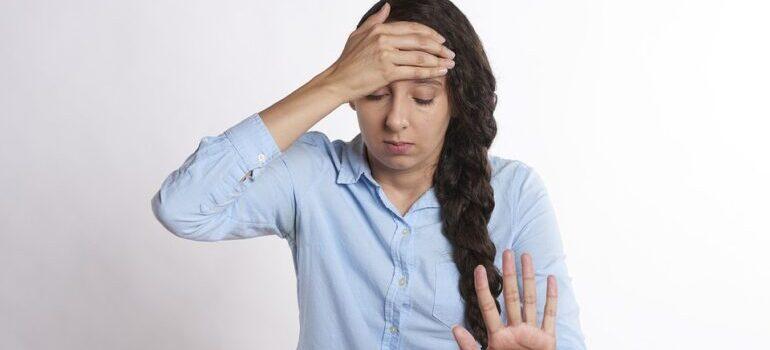 Upset women holding her forehead
