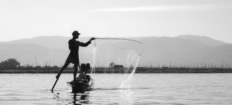 a picture of a person fishing on a lake
