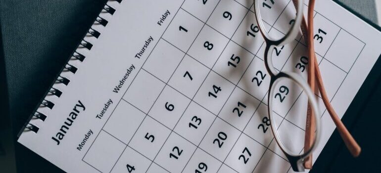 Eyeglasses on the calendar as symbol that right date can cut costs of your relocation to DC